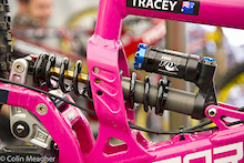 "Tracy is rocking the Kashima coated rear shock, but not a ti spring. Yet. As Justin Frey from Fox Racing once quoted to me, ""Ti springs aren't given, but rather earned."" Cable and hose route through the interrupted seat tube and below the rear shock."