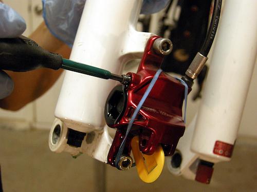unscrew caliper bleed plug